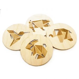 lasered wooden table coasters of a geometric bunny, elephant, pig and hummingbird